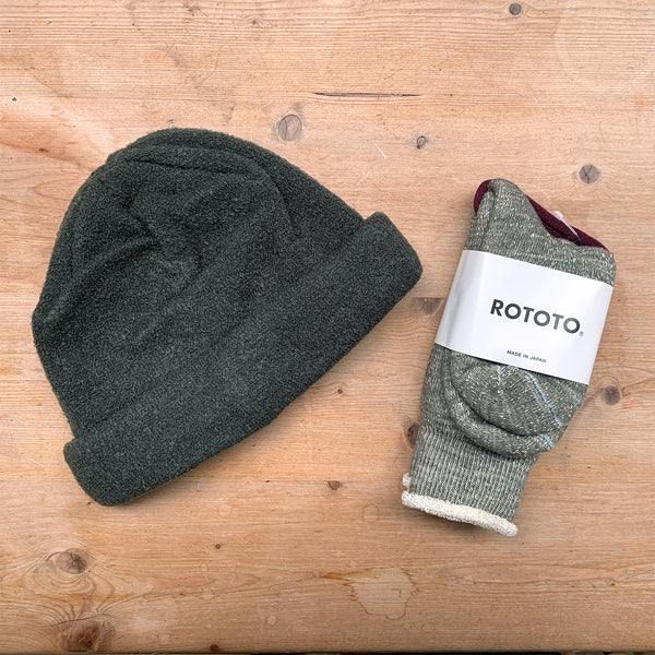 dark green knitted beanie hat and socks