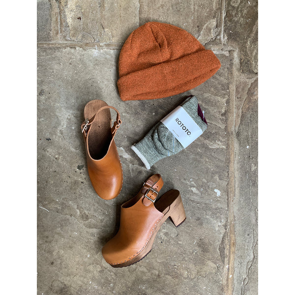 burnt orange knitted beanie hat, socks and clogs