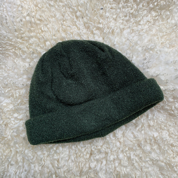 dark green knitted beanie hat