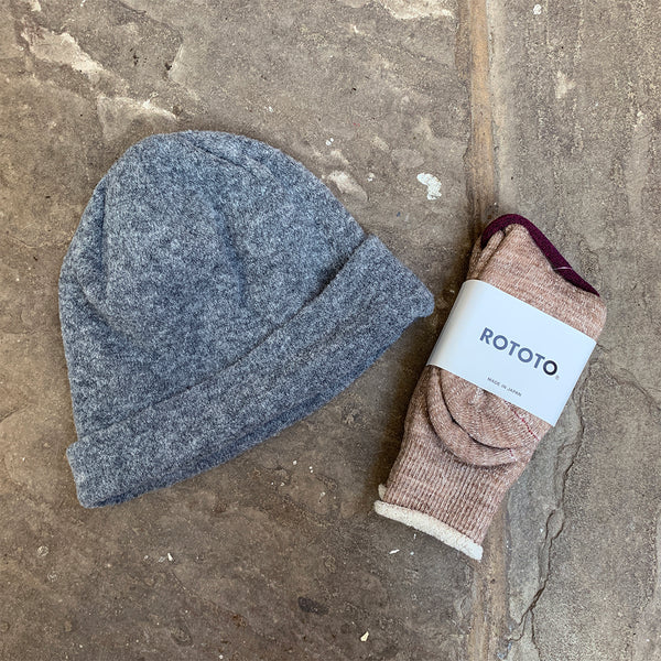 grey knitted beanie hat and socks