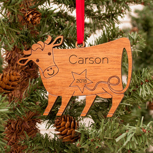 Handmade original cow Christmas ornament personalized in choice of wood & engraved by Graphic Spaces