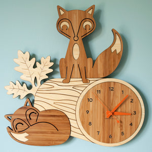 Sleeping Fox Log Bamboo Wall Clock for woodland animal decor handmade by Graphic Spaces