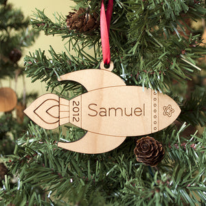 Handmade original outer space rocket Christmas ornament personalized in choice of wood & engraved by Graphic Spaces