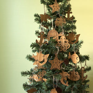 Ocean Animal Christmas Ornaments handmade in eco-friendly bamboo by Graphic Spaces displayed on Christmas tree