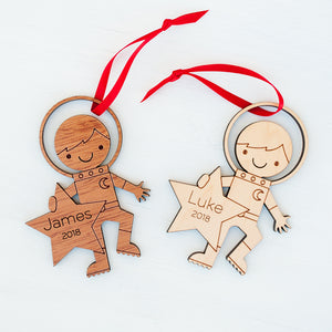 Original handmade space astronaut Christmas ornament personalized in choice of wood & engraved with name by Graphic Spaces
