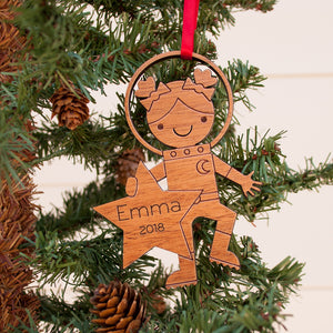 Original handmade space astronaut girl Christmas ornament personalized in choice of wood & engraved by Graphic Spaces