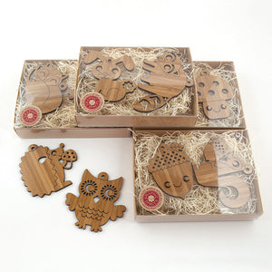 Wooden Animal Christmas Ornaments handmade in eco-friendly bamboo by Graphic Spaces in gift boxed packaging