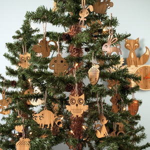 Woodland Animal Christmas Ornaments handmade in eco-friendly bamboo by Graphic Spaces displayed on Christmas tree