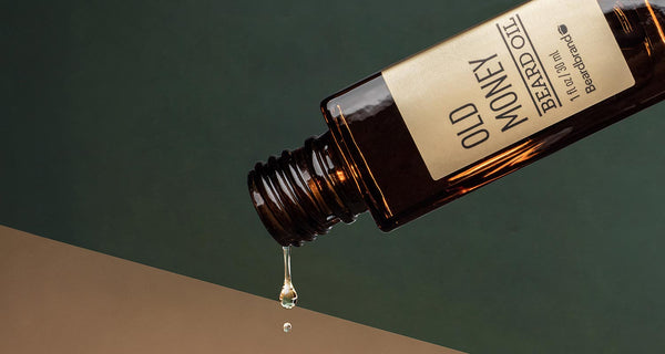 Beard Oil being poured from a bottle of Beardbrand Old Money Beard Oil.