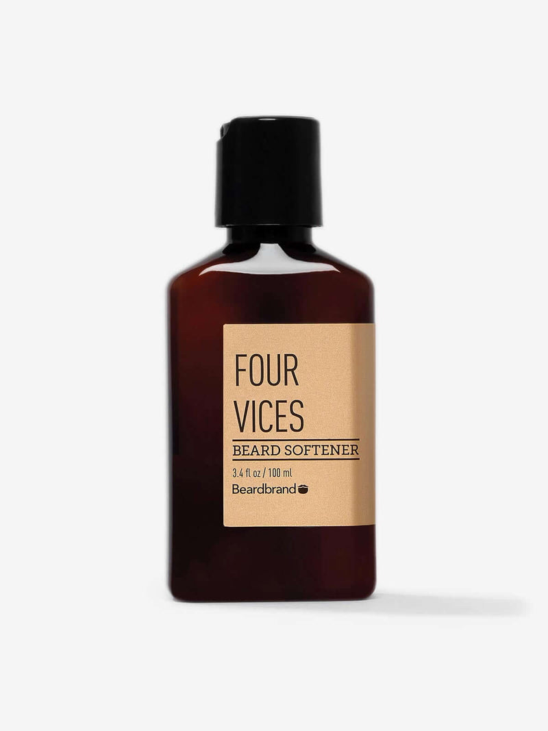 A bottle of Beardbrand Four Vices Beard Softener on a striking gray backdrop.