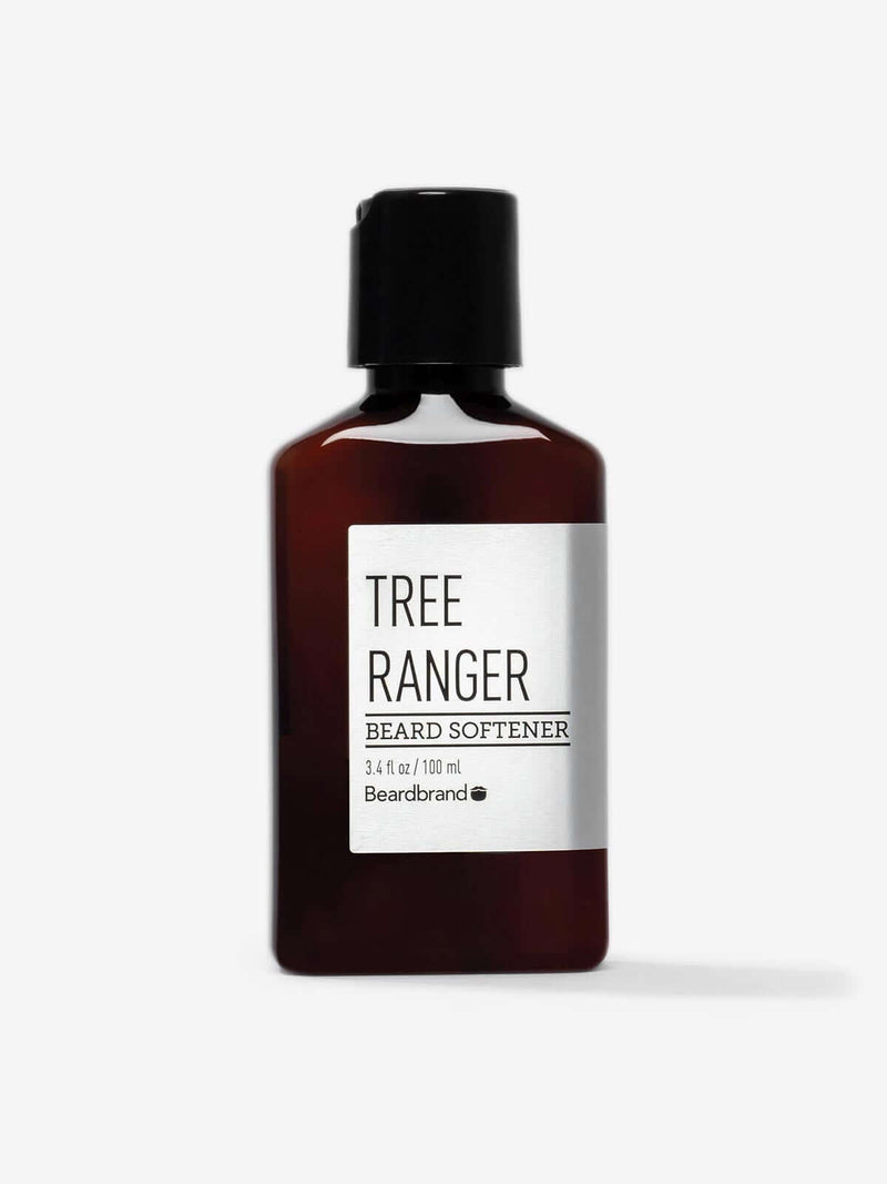 A bottle of Beardbrand Tree Ranger Beard Softener on a striking gray backdrop.