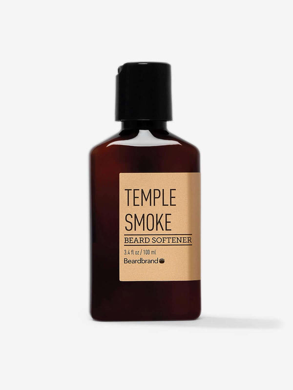 A bottle of Beardbrand Temple Smoke Beard Softener on a striking gray backdrop.