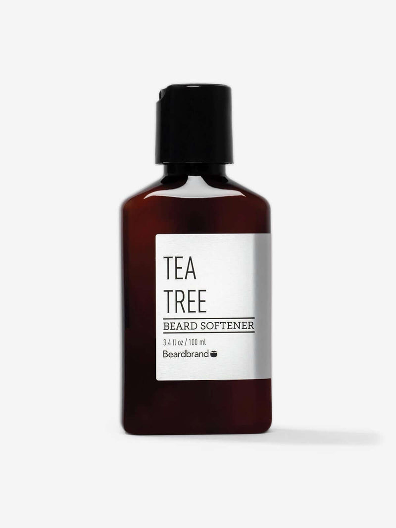 A bottle of Beardbrand Tea Tree Beard Softener on a striking gray backdrop.
