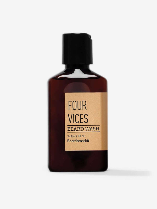 A bottle of Beardbrand Four Vices Beard Wash on a striking gray backdrop.