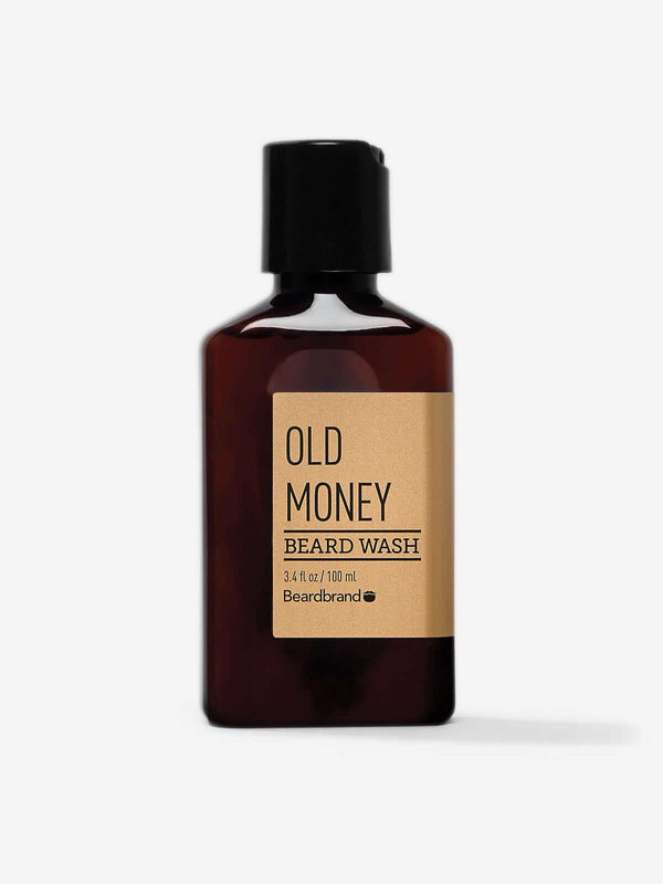 A bottle of Beardbrand Old Money Beard Wash on a striking gray backdrop.