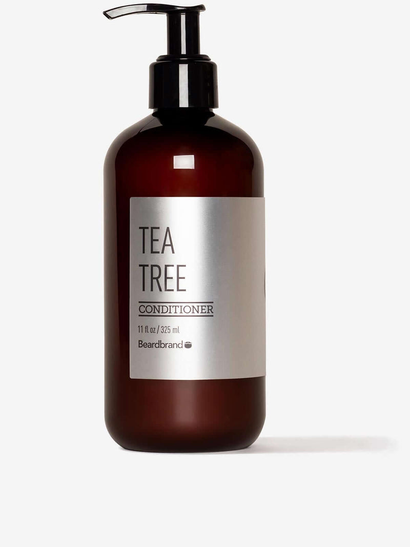 A bottle of Beardbrand Tea Tree Conditioner on a striking gray background.