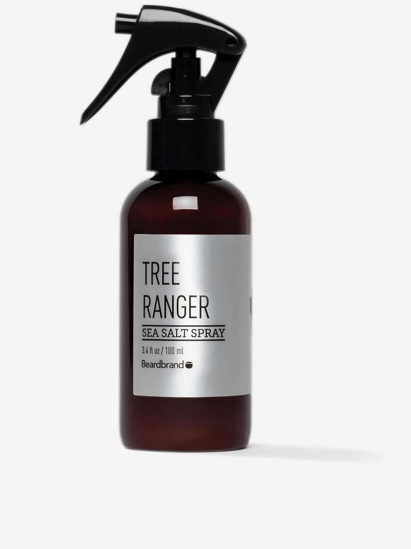 A bottle of Beardbrand Tree Ranger Sea Salt Spray on a striking gray backdrop.