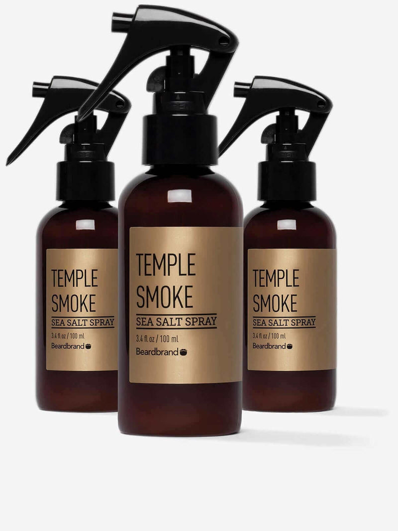 Three bottles of Beardbrand Temple Smoke Sea Salt Spray.