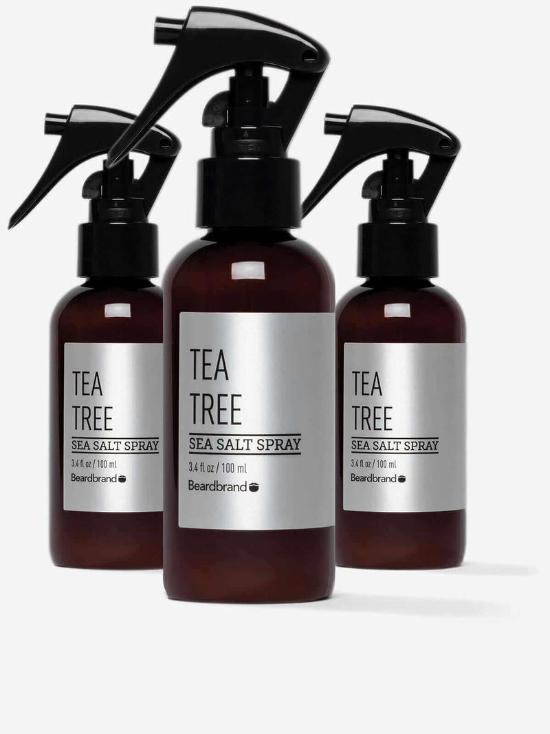 Three bottles of Beardbrand Tea Tree Sea Salt Spray.