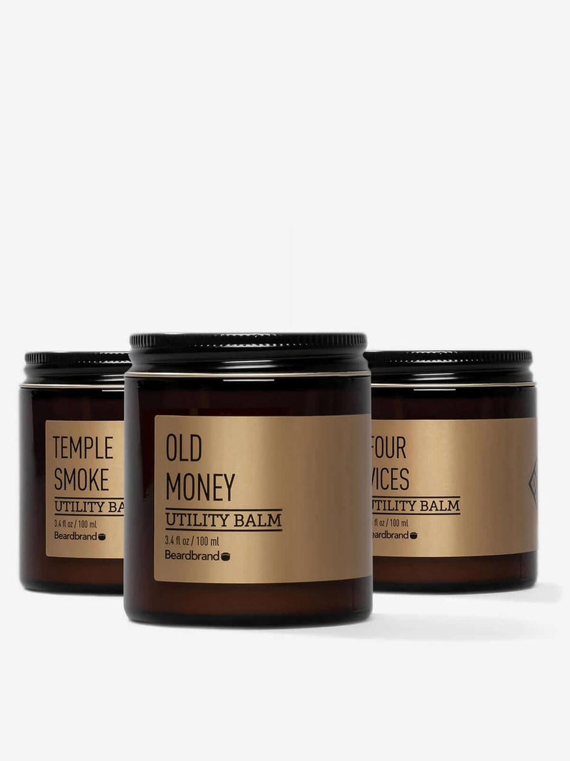 Three jars of Beardbrand Silver Line Utility Balm: Old Money, Temple Smoke, and Four Vices.