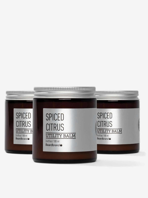 Three jars of Spiced Citrus Beardbrand Silver Line Utility Balm.