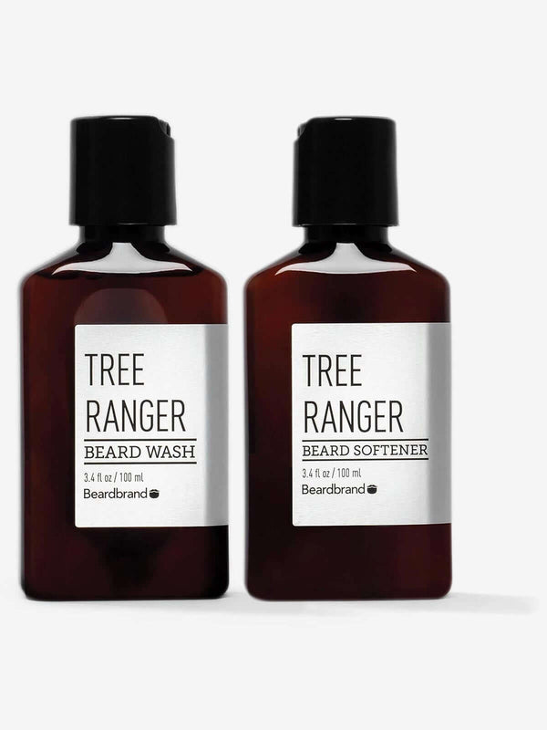 A bottle of Beardbrand Tree Ranger Beard Wash next to a bottle of Beardbrand Tree Ranger Beard Softener.