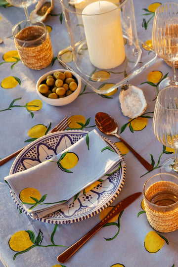YOLKE Linen Lemon Napkin on a plate with matching tablecloth
