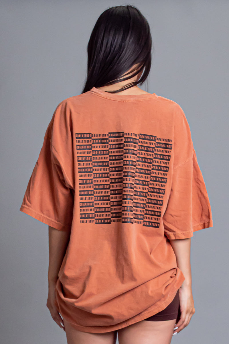 BURNT ORANGE N BLK CHECKER TEE