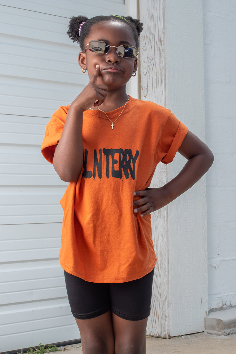 KIDS ORANGE N BLK SPRAY TEE