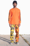 GUYS ORANGE N BLK TRAP TEE