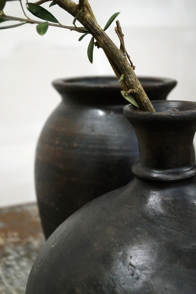 Tall Clay pot with a beautiful dark patina