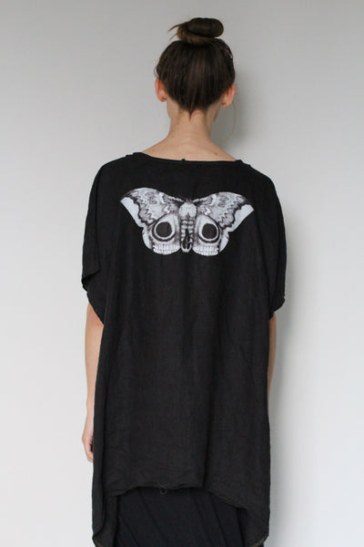 Window Dressing the Soul Curved Hem Top-Moth on Back