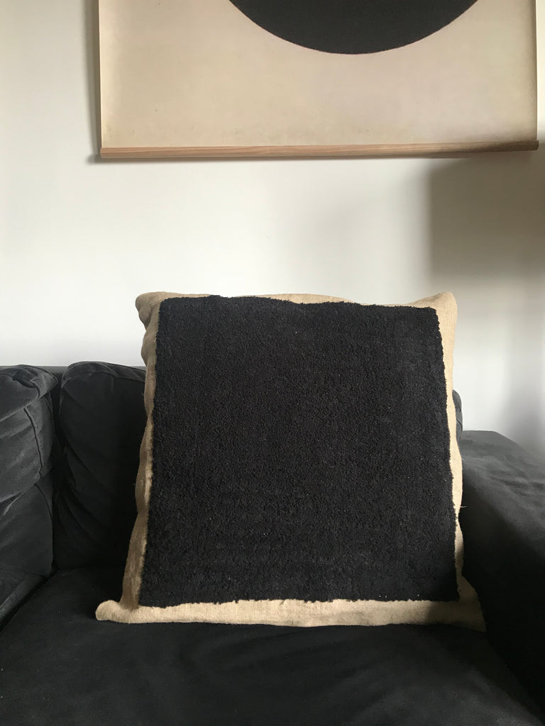 Black square embroidered cushion