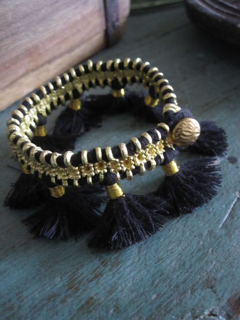 multi tassel black and brass bracelet