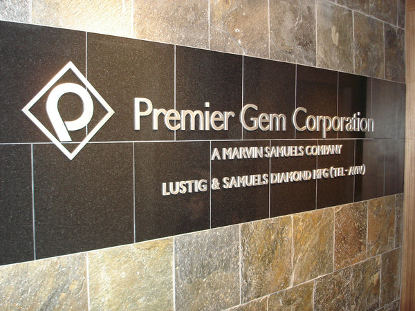 Custom cut out aluminum logo/letters mounted to customers granite wall