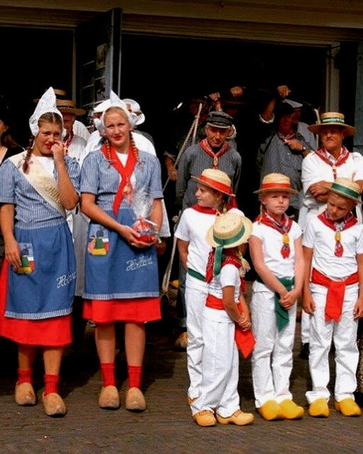 locals in Edam wearing traditional clothing at the cheese market