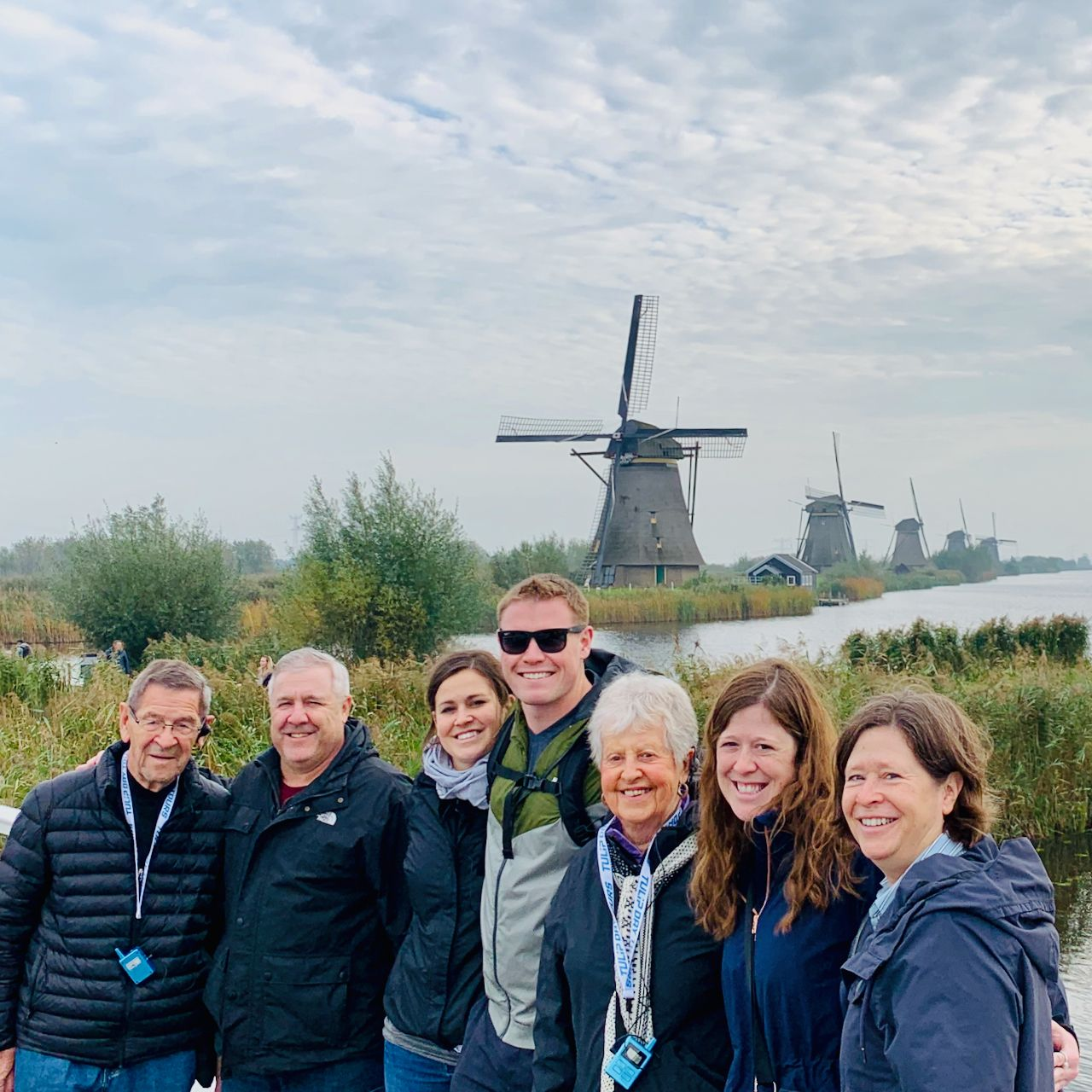 an american family wearing  on a private tour to the authentic windmills of holland