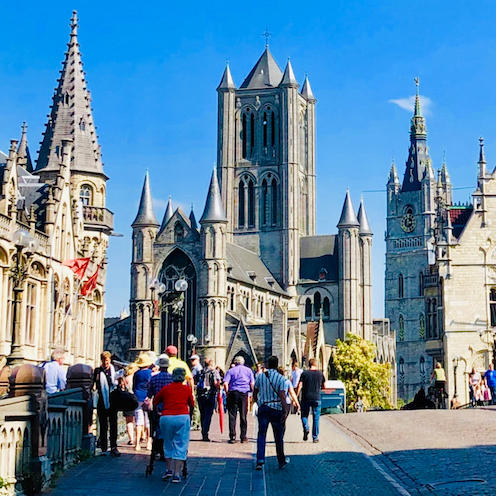 a street view image of Ghent in Belgium with medieval architecture