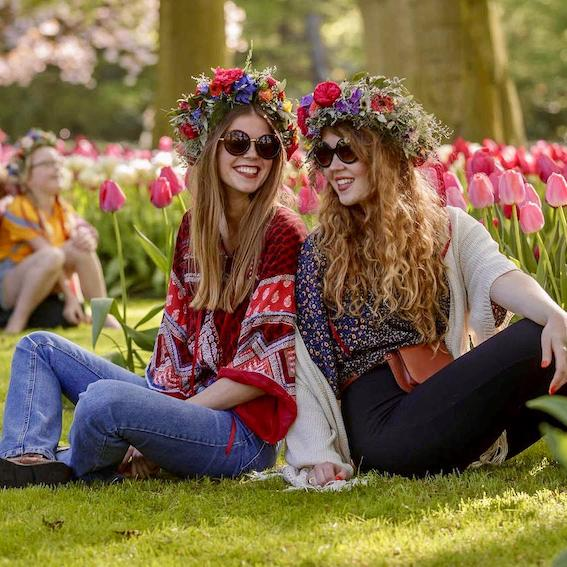 image of two girls sitting in the tulips in holland