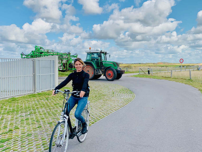 image of a the prettiest tour guide in the world  cycling along the Wadden Sea Dyke on Texel Island