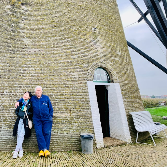 visit the real windmills in holland and meet the miller who wears his traditional wooden shoes