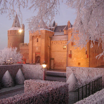Small Castle of Amsterdam Muiderslot covered in snow in the winter