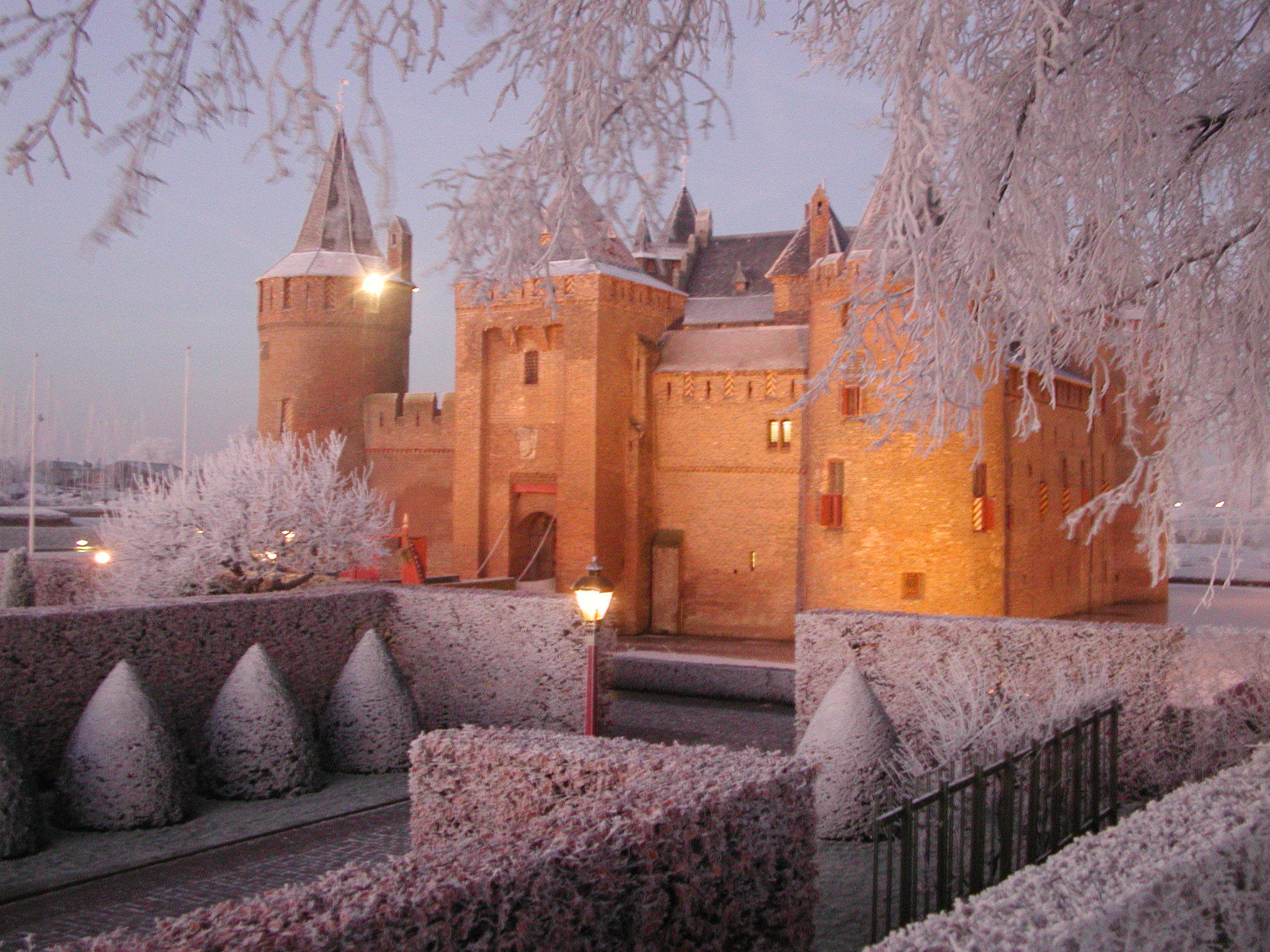 amsterdam muiderslot castle covered with snow and lights in the winter during christmas with tulip tours