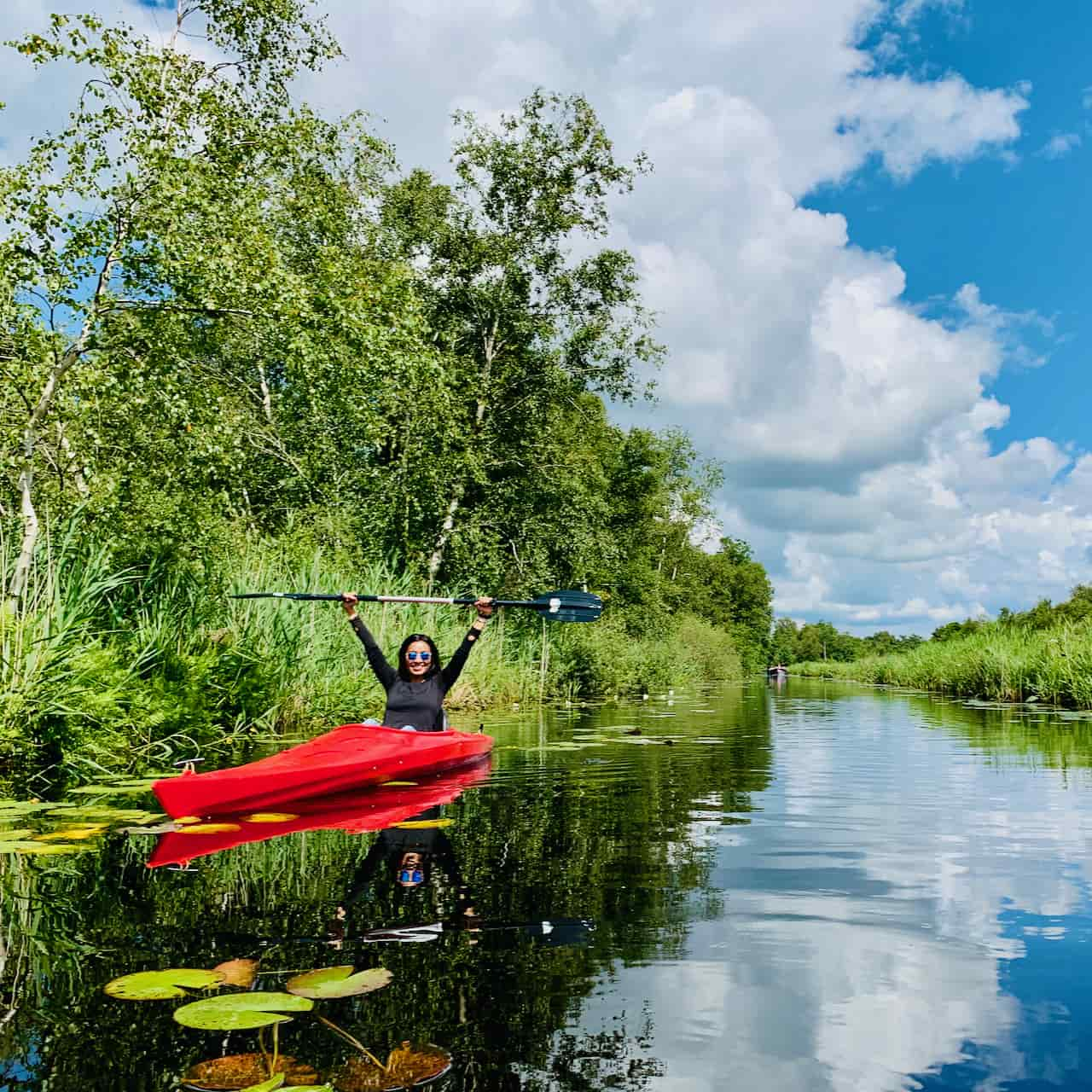 explore authenticity and  Dutch nature with a kayak tour in national park weerribben with tulip day tours and escape mass tourism