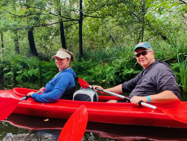 a couple in red kayaks on a private tour to national park weerrribben with tulip day tours