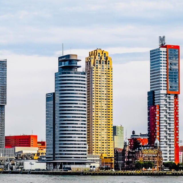 a view from the Maas river on the skyline of Rotterdam with its impressive and innovative architecture that is known all over                                                                                                                                  the world