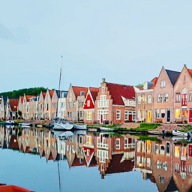 typical Dutch red-roofed houses along the canal in Edam Holland