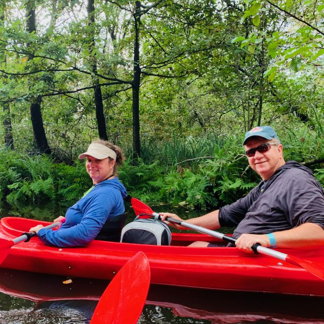 an American couple in a kayak peddling in national park holland with tulip tours