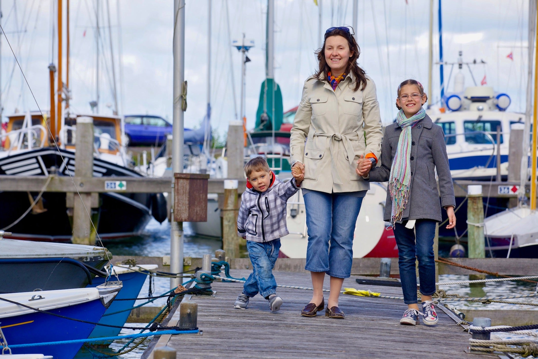a beautiful image of a woman with her two children in the harbor of Volendam during corona crisis in holland