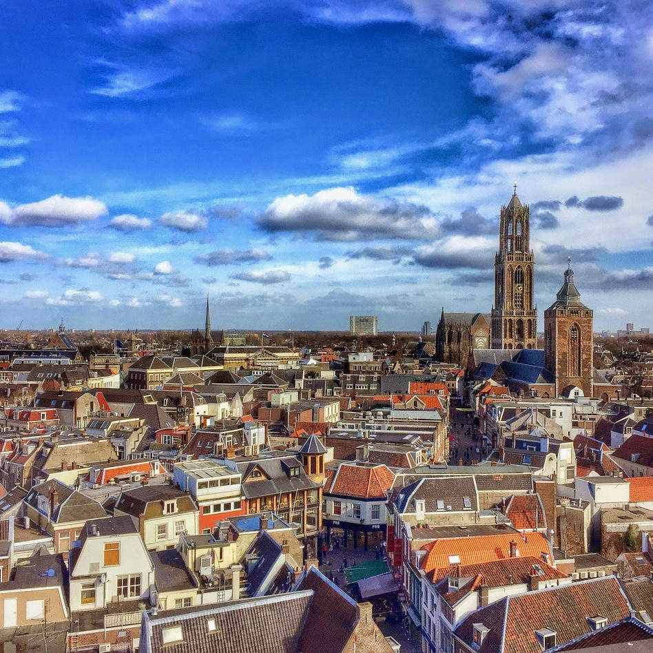 discover Utrecht with a private tour by tulip day tours and have an amazing view on the medieval rooftops of the city